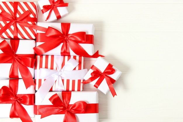 Set of beautifully wrapped gift boxes on a colored background top view