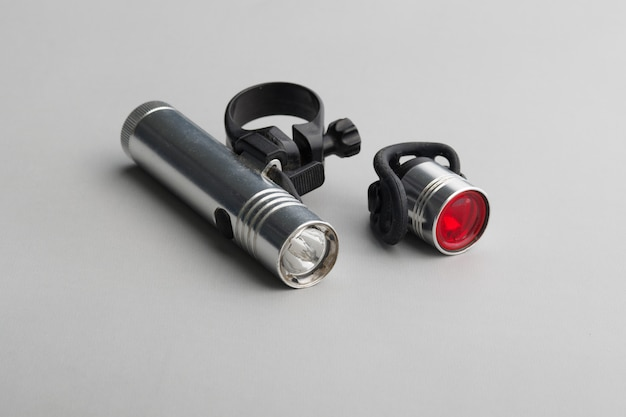 Set of bicycle lights and mounts on a gray surface