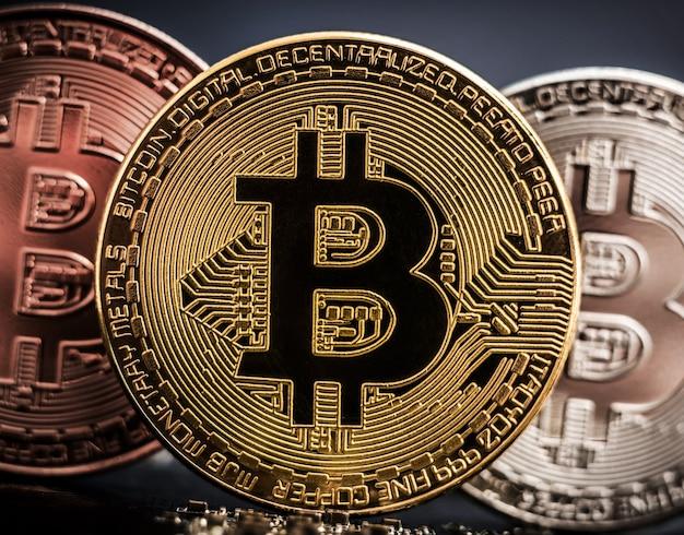 Set of bitcoins on computer circuit board