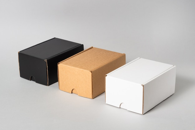 Set of black, brown and white cardboard boxes, isolated
