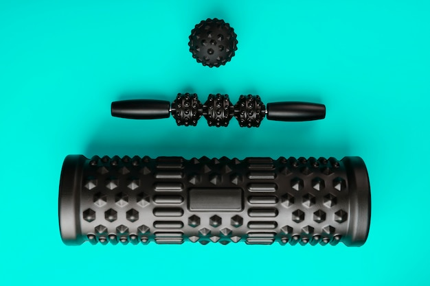 Set of black bumpy foam massage rollers, body rollers and rubber balls