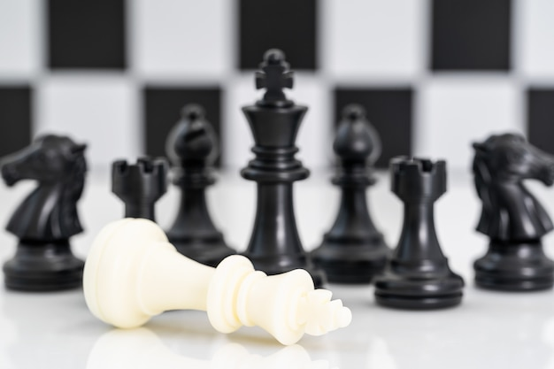 Set of black and white chess pieces on white background