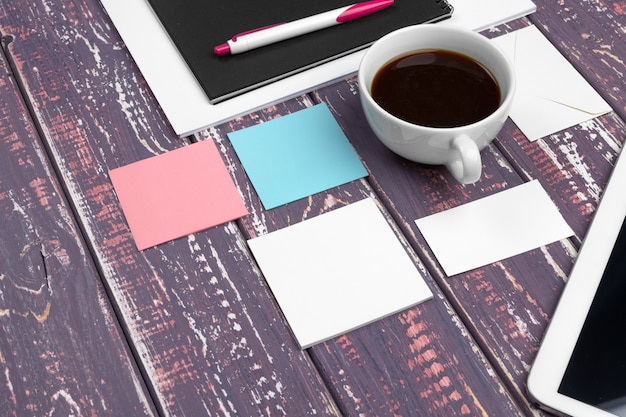 Set of blank business cards, notebook and cup of coffee.
