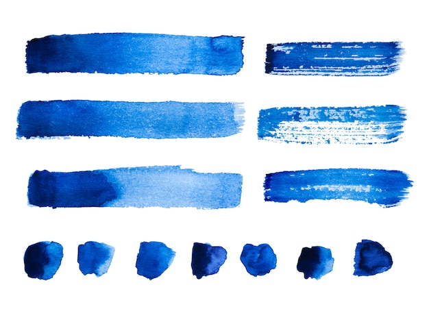 Set of blue abstract watercolor strokes and stains isolated on white background