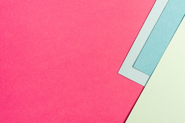 Set of blue and pink paper sheets with copy space