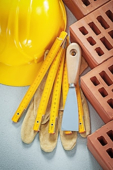 Set of bricklaying tools on concrete background building concept