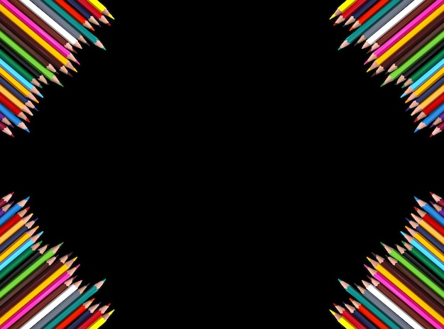 Set of bright colored pencils on black background. back to school design elements. empty space for text.