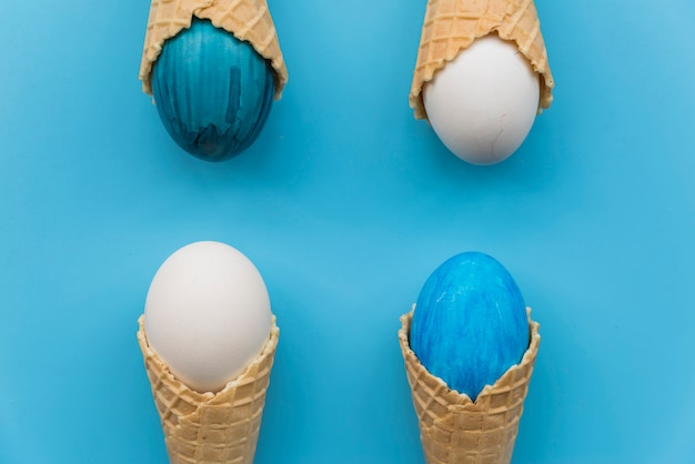 Set of bright easter eggs in waffle cones
