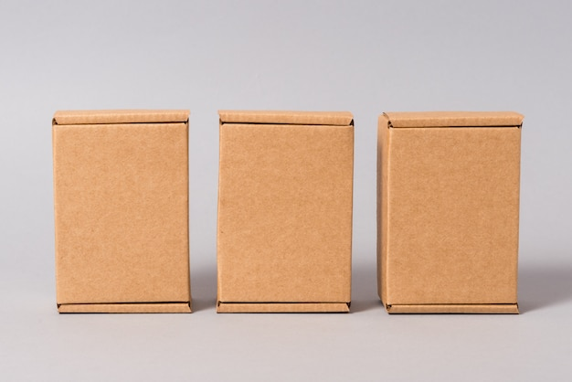 Set of brown cardboard boxes on grey background
