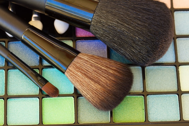 Set of  brushes on colorful  eye shadows palette