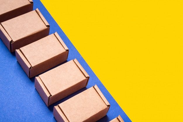 Set of cardboard boxes on blue yellow background
