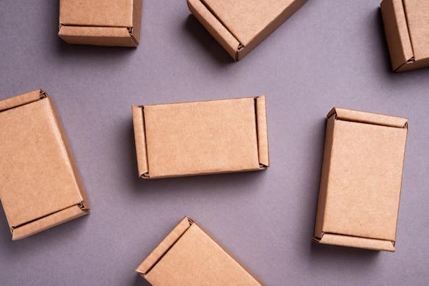 Set of cardboard boxes on grey background