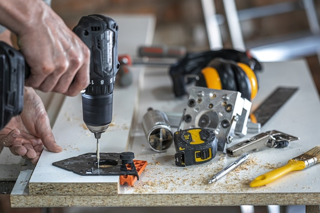 A set of carpenter's tools, accessories for precision drilling and wood measurement.