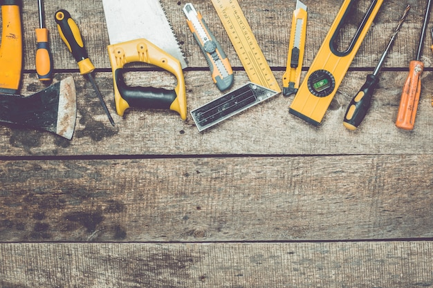 Set of carpentry tools on rustic wooden background top view