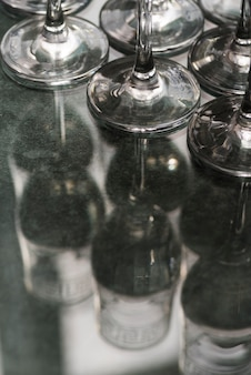 Set of champagne glasses on glass surface