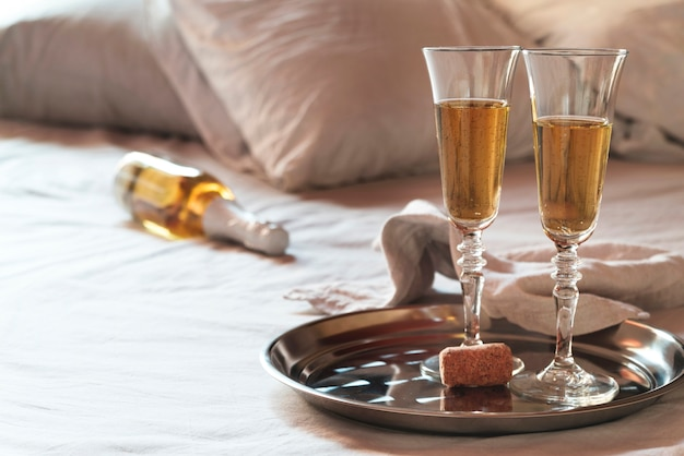 Set of champagne glasses on a tray