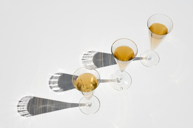 Set of champagne glasses with long sunlight shadow. still life