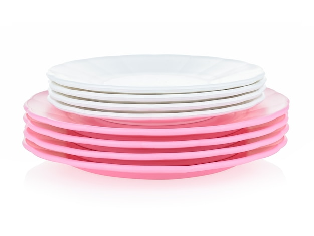 A set of children's tableware made of pink plastic on a white background.