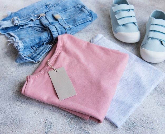 Set of childrens clothes the concept of online shopping