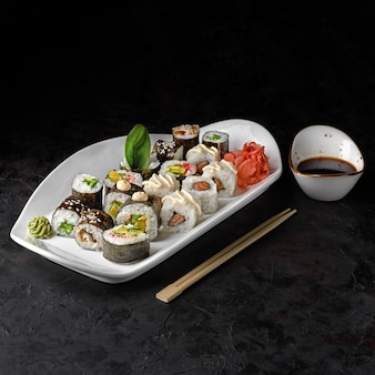 Set of classic rolls - maki with eel, salmon, cucumber, and vegetable roll futo maki