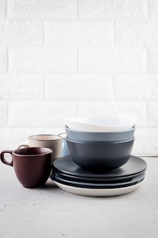 Set of clean tableware on gray concrete