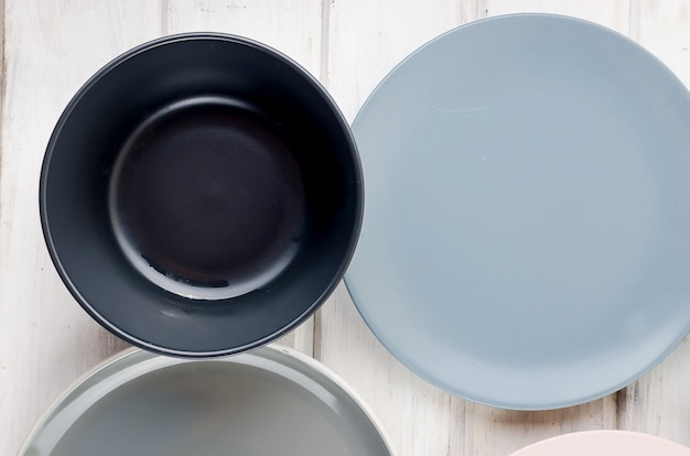 Set of clean tableware pastel color on wooden