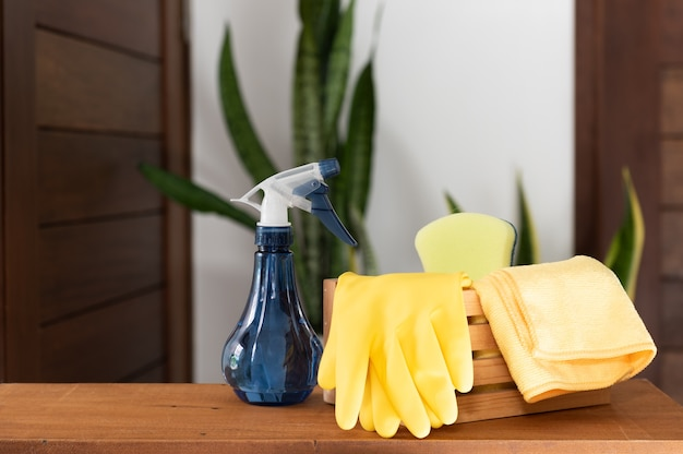 Set of cleaning supplies on wooden table