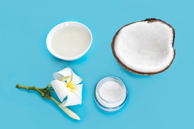 Set of coconut for beauty, health of hair, face, skin. coconut cut in half, coconut oil, cream, flower. beauty healthcare concept. coconut cosmetic fresh organic natural products.
