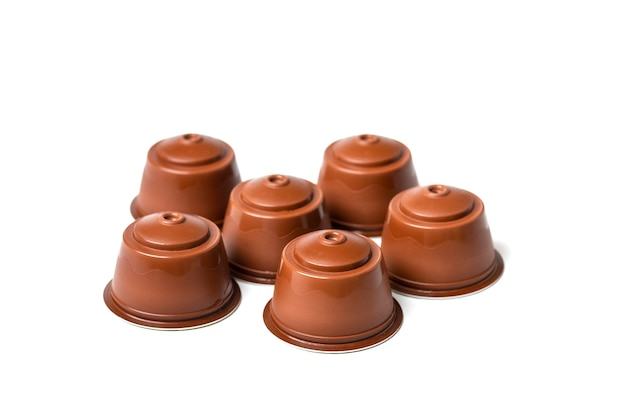 Set of coffee capsules, roasted beans isolated on white