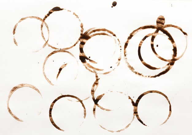 Set of coffee cup stains isolated on white background. dry rings of bracing beverage. collection of brown spots for grunge design
