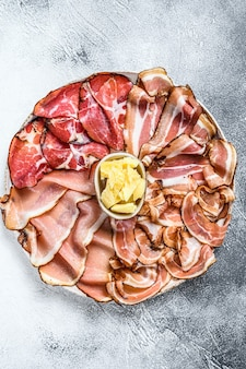 Set of cold cured italian meat ham, prosciutto, pancetta, bacon