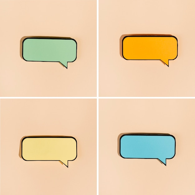 Set of colored comic bubbles on beige background