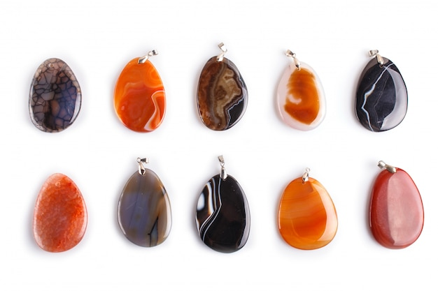 Set of colored onyx pendants isolated on white surface
