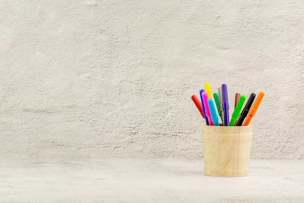 Set of colored pencils on the desk. - education and back to school concept.