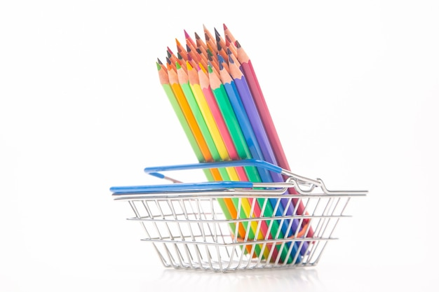 Set of colored pencils for drawing in the market basket. marketing in business sales