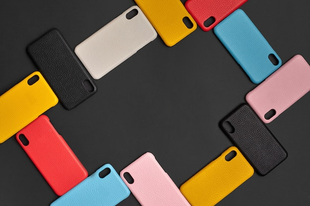 Set of colorful protective smartphone cases or covers on black