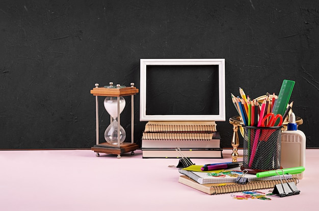 Set of colorful school supplies, books and notebooks. stationery accessories.