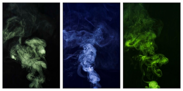 Set of colorful smoke swirling around against black background