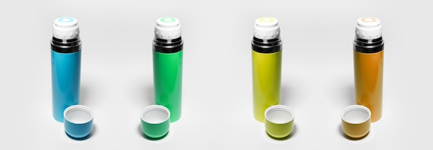 Set of colorful thermos isolated on white