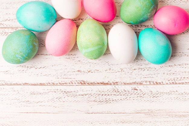 Set of colourful easter eggs on board