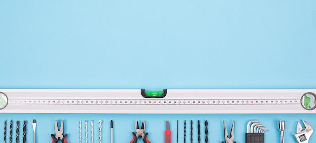 Set of construction tools on blue background