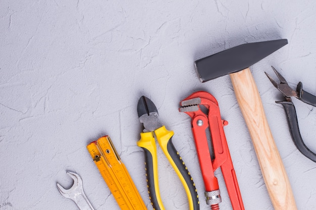 Set of construction tools on gray background