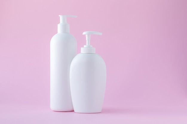 Set of cosmetic bottles with dispenser. copy space, empty place