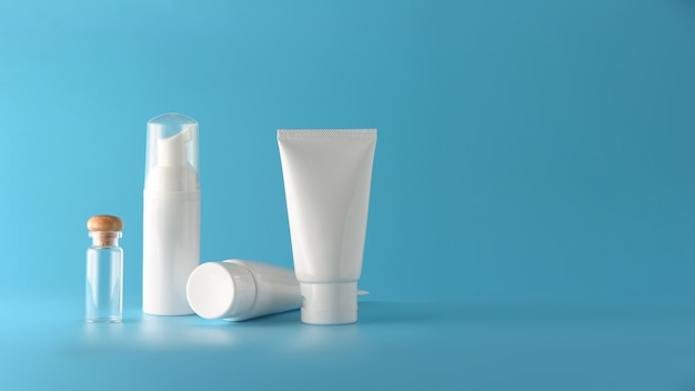 Set of cosmetic products on a color background.