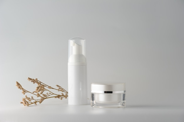 Set of cosmetic products on white background.