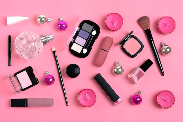 Set of cosmetics and accessories - lipstick, eye shadow, nail polish, brush, blush
