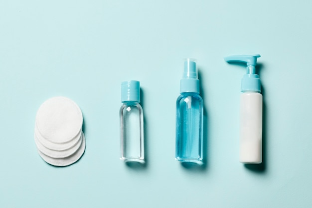 Set of cosmetics on a blue background. flat lay.
