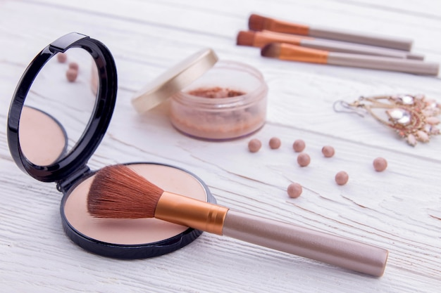 Set of cosmetics and jewellery with make-up brushes