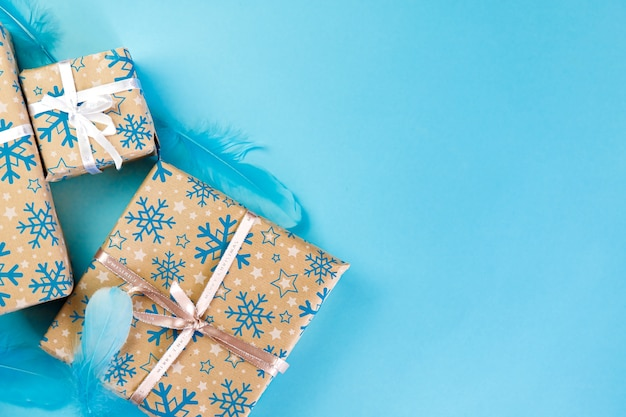 Set of cristmas boxes with ribbons and illustrations full of presents.