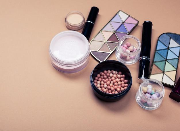 Set of decorative cosmetics on beige